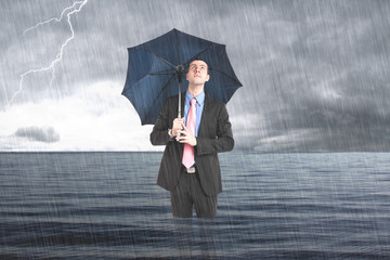 Businessman under the rain