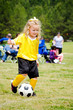 Girl in uniform playing in organized youth league soccer game