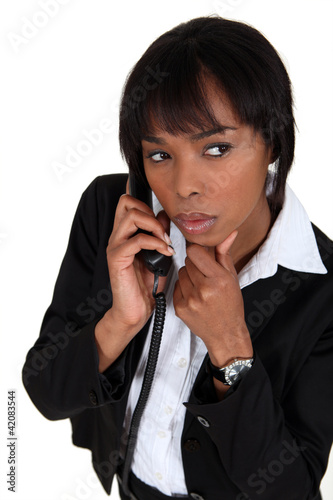 Suspicious woman talking on the phone