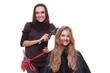 smiley hairdresser doing curly hair