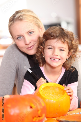 Girl decorating pumpkin