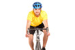 A smiling bicyclist with yellow shirt posing on a bicycle