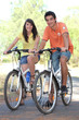 Young couple riding their bikes