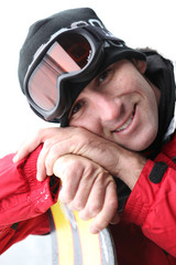 portrait of skier with hands resting on skis