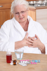 Elderly lady taking her medication