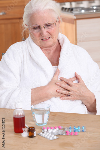 Elderly lady taking her medication