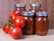 Tomato sauce in jars and tomatoes