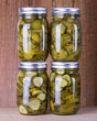Pickled cucumbers in brine in mason jars