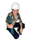 Tradeswoman holding up a power tool