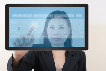 Business lady pushing keyboard on the tablet screen.