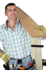 Handyman holding plank