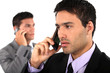 Young businessmen on the phone