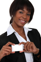 African woman showing card