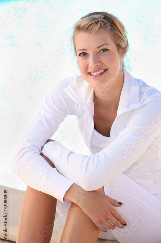 Blonde woman dressed in white