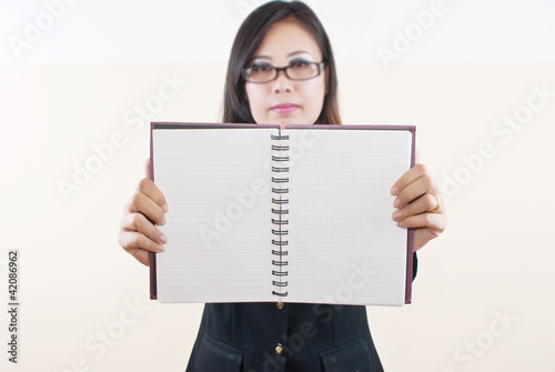Businesswoman take her blank notebook for business concept.