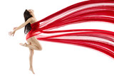 Fototapety Woman dancing with red flying waving chiffon cloth. Dancer with