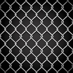 Metal fence on a dark background.