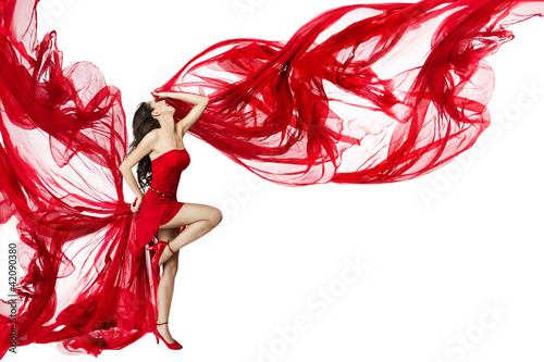 Beautiful woman dancing in red dress flying on a wind flow over