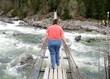 Obese woman on a suspension bridge