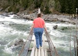 Obese woman on a suspension bridge