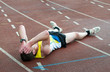 man lying on the ground at sport