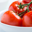 Closeup of fresh tomatoes in a bowl