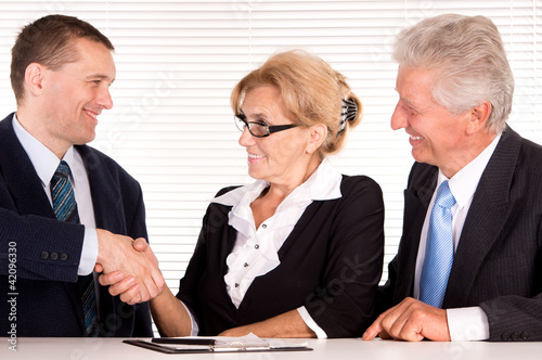 three people at office