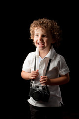 young child holding a camera
