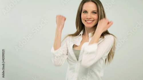 Successful young woman gesturing; Full HD Photo JPEG