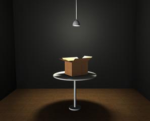 Una caja de cartón abierta iluminada en una habitación.