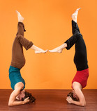 Two Ladies in Yoga Head Stands