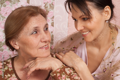 A good older woman with her adult daughter