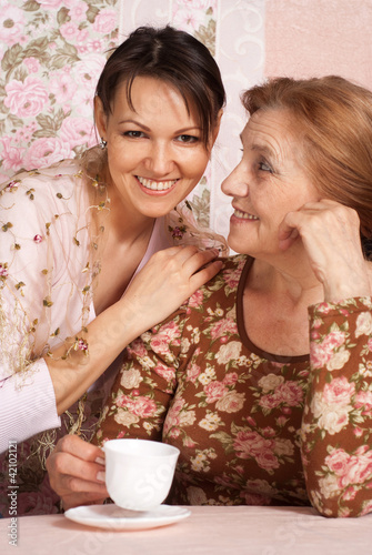 A beautiful nice older woman with her adult daughter