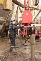 Worker in rig floor