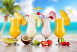Fototapety Pina colada drinks with blur beach on background