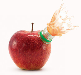 Red apple with bottle neck and juice splashes on white