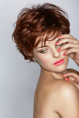 woman with short hair and pink manicure
