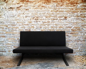 modern sofa in old brick wall room setting