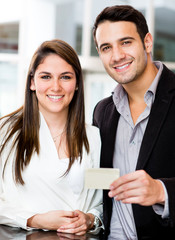 Couple holding a credit card