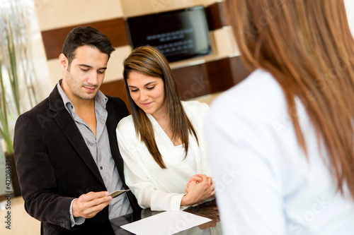 Couple doing check-in at a hotel