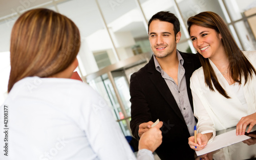 Loving couple checking in a hotel