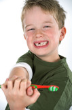boy demonstrate toothbrush
