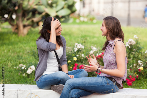 Two Young Women on a Bench at Park