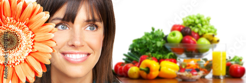 Beautiful woman with flower and vegetables.