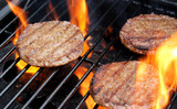 Sizzling hamburgers on the grill