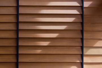 sunlight on wooden wall