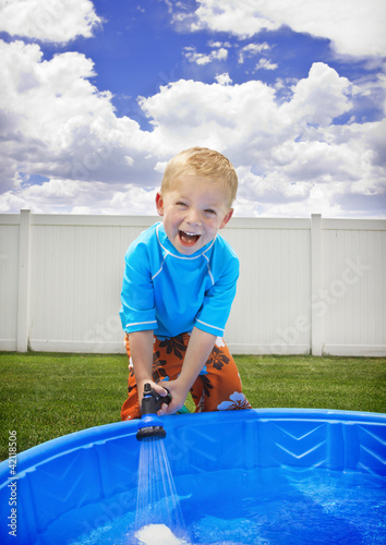 Little Boy playing outside in the Summer