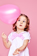 Sweet  girl with pink balloon