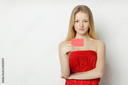 Young woman holding blank credit card