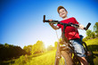 boy with bike standing against the blue sky